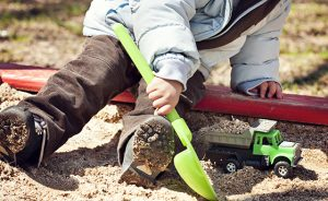 A child playing in the sandbox