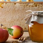 Honey jar with fresh apples