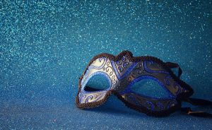 elegant venetian mask on blue glitter background