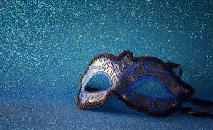 elegant venetian mask on blue glitter background