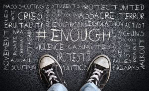 Teen Wearing Canvas Shoes on Asphalt With # Enough Word Cloud