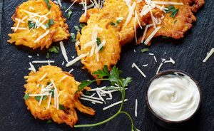 Pumpkin fritters on a black stone board, vertical