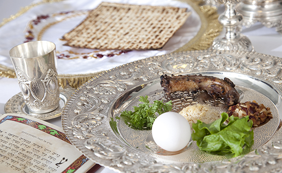 Passover food on silver plate on table