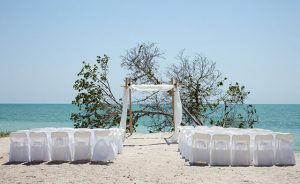 beach wedding chuppa canopy arbor and chairs facing ocean