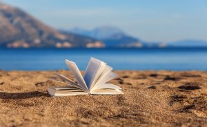 Open book on the beach with sea view